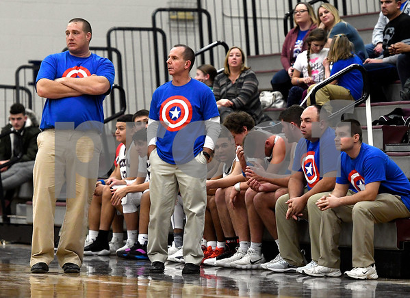 1/2/2018 Mike Orazzi | Staff The Bristol Central Boys Basketball coaching staff on Captain Connor night during the boys basketball game with Southington in Bristol.