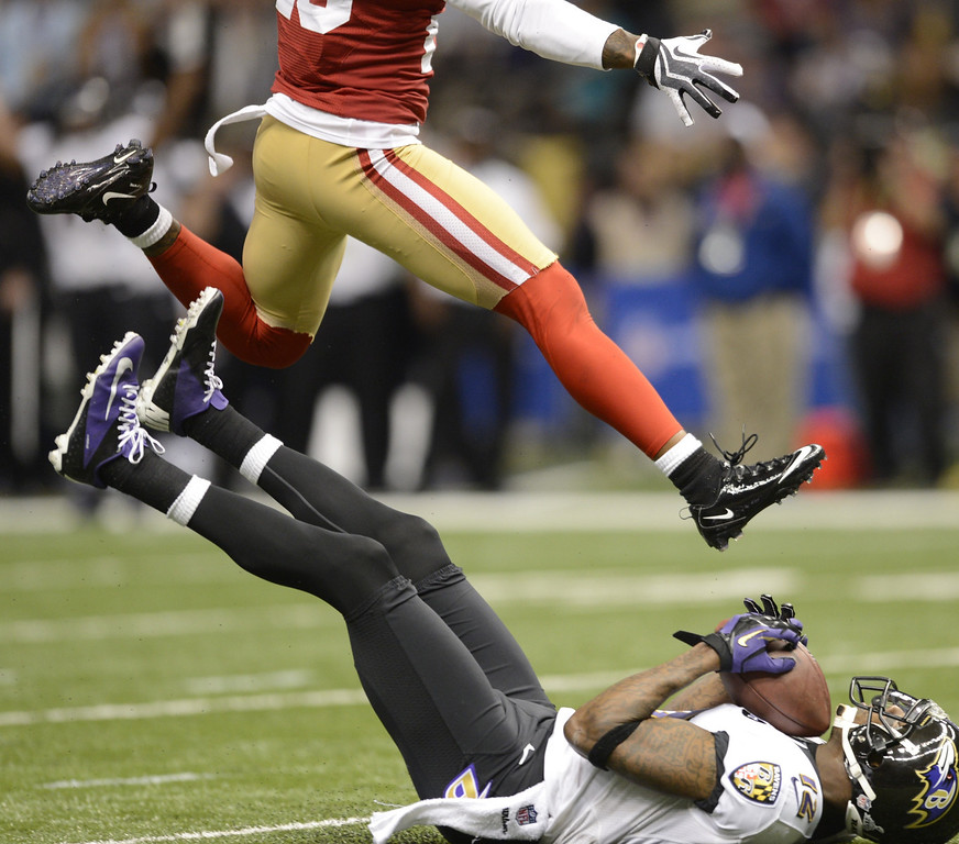 . Jacoby Jones (R) of the Baltimore Ravens falls with the ball in the second quarter against the San Francisco 49ers during Super Bowl XLVII at the Mercedes-Benz Superdome on February 3, 2013 in New Orleans, Louisiana.   TIMOTHY A. CLARY/AFP/Getty Images