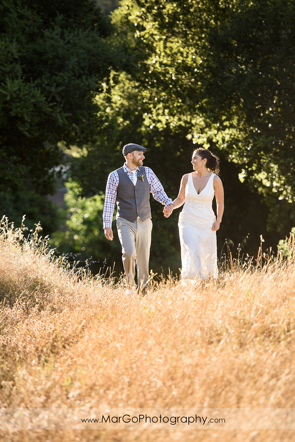 bride and groom walking at Picchetti Winery in Cupertino