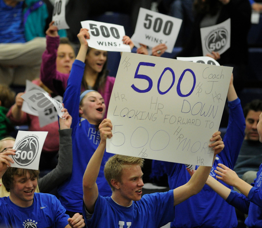 . PARKER, CO. - FEBRUARY 15: Ranch students held signs marking the historic win Friday night. The Highlands Ranch High School girls\'s basketball team defeated Legend 76-31 Friday night, February 15, 2013. Falcon\'s coach Caryn Jarocki earned her 500th career win. (Photo By Karl Gehring/The Denver Post)