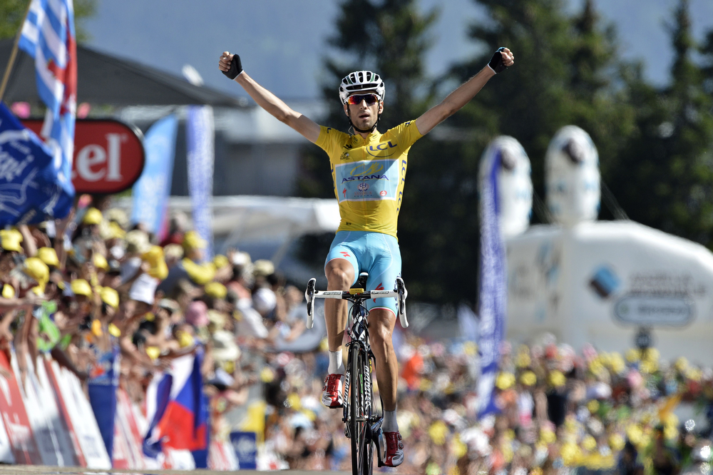 . Italy\'s Vincenzo Nibali wearing the overall leader\'s yellow jersey celebrates as he crosses the finish line at the end of the 197.5 km thirteenth stage of the 101st edition of the Tour de France cycling race on July 18, 2014 between Saint-Etienne and Chamrousse, central eastern France.  (JEFF PACHOUD/AFP/Getty Images)
