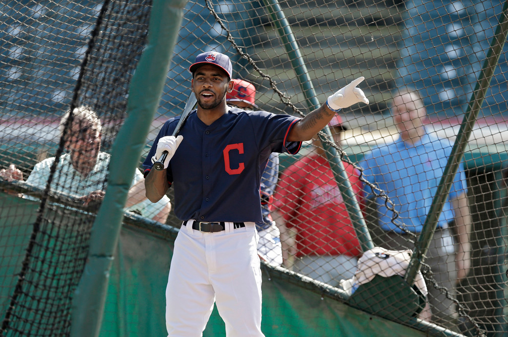 . Cleveland Cavaliers\' Kyrie Irving takes batting practice with the Cleveland Indians before a baseball game against the Los Angeles Angels Monday, June 16, 2014, in Cleveland. (AP Photo/Mark Duncan)