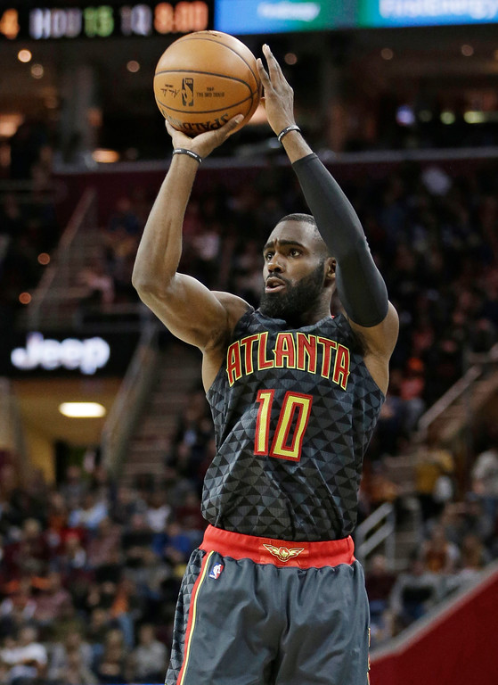 . Atlanta Hawks\' Tim Hardaway Jr. (10) shoots against the Cleveland Cavaliers in the first half of an NBA basketball game, Friday, April 7, 2017, in Cleveland. (AP Photo/Tony Dejak)