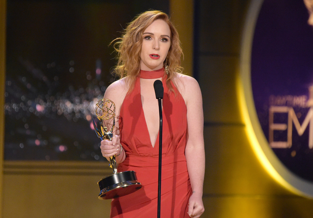 ". Camryn Grimes accepts the award for outstanding supporting actress in a drama series for ""The Young and the Restless\"" at the 45th annual Daytime Emmy Awards at the Pasadena Civic Center on Sunday, April 29, 2018, in Pasadena, Calif. (Photo by Richard Shotwell/Invision/AP)"