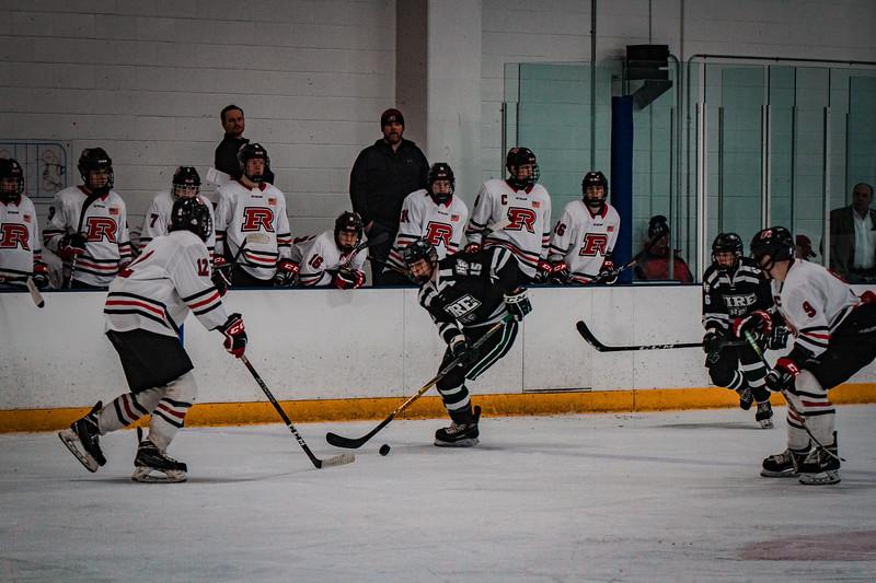 Holy Family Boys Varsity Hockey vs. Elk River, 12/27/19: Marc Lund '21 (15)