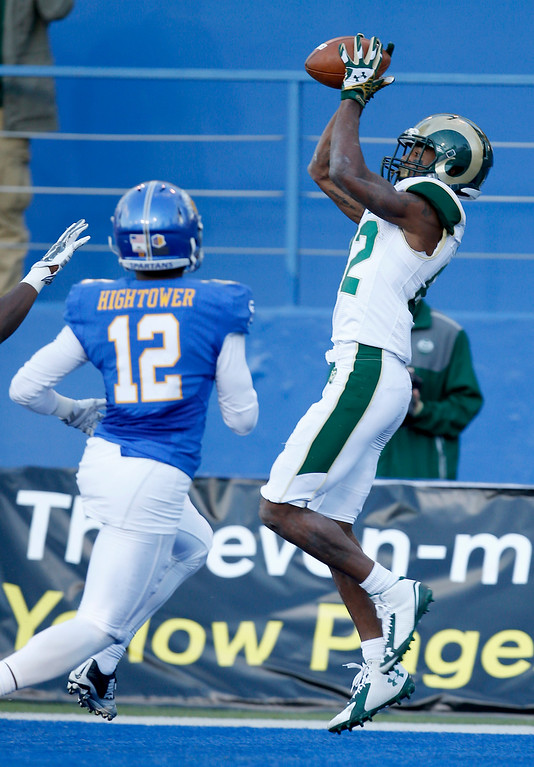 . Colorado State wide receiver Rashard Higgins (82) catches a touchdown pass against San Jose State safety Forrest Hightower (12) during the first half of an NCAA college football game Saturday, Nov. 1, 2014, in San Jose, Calif. (AP Photo/Tony Avelar)