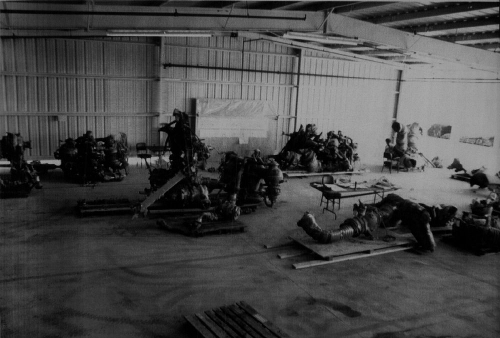 Description of . Large portions of the Space Shuttle Challenger\'s three main engines have been recovered from the floor of the Atlantic  Ocean by salvage crews. They are shown in a storage facility at Complex 39 on the Kennedy Space Center in this photograph released by Nasa late Thursday afternoon.