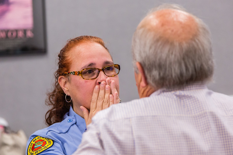 Dispatcher Melissa Behn reacts to meeting Bob Stephens for the first time on Thursday, August 25, 2016 at the Palm Beach County Dispatch Center in West Palm Beach. Stephens called 911 when his wife Carrie started hemorraging in their home in Boca Raton on January 15, 2016 and Behn talked him through slowing the bleeding until Palm Beach County Fire Rescue could arrive to take her to the hospital where she received a transfusion which saved her life. (Joseph Forzano / The Palm Beach Post)