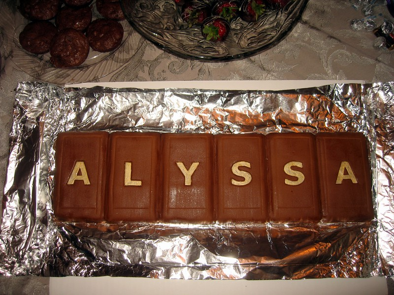 Alyssa's Candy Bar Cake, by Olivia and Craig (7/31/10) (Click here for more photos) The inside is brownie, and the outside is brown fondant.  The letters are embossed in the fondant and painted with edible gold dust.