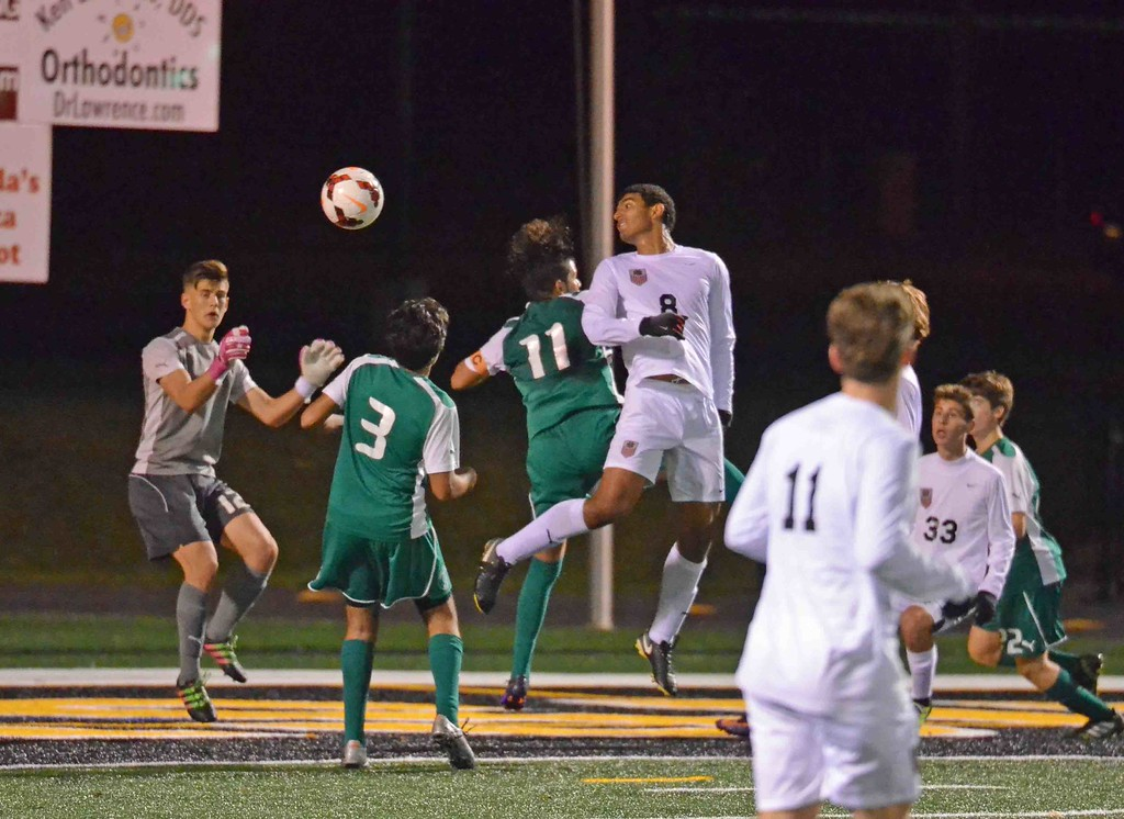 . Paul DiCicco - The News-Herald University\'s George Nageeb goes for a header Oct. 28.