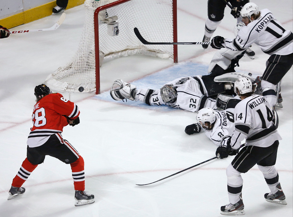 . Chicago Blackhawks right wing Patrick Kane (88) scores a goal during the first period in Game 5 of the NHL hockey Stanley Cup playoffs Western Conference finals against the Los Angeles Kings, Saturday, June 8, 2013, in Chicago. (AP Photo/Charles Rex Arbogast)