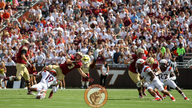 Boston College WR Michael Walker watches as his fumbled football flies through the air after a hit from Chuck Clark (19). (Mark Umansky/TheKeyPlay.com)