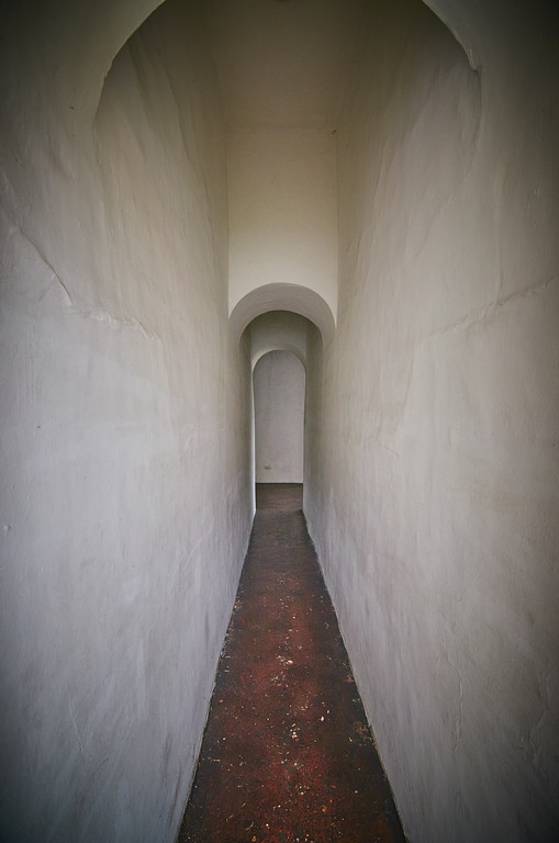 Long White tunnel with archs and an old  burgany concrete floor