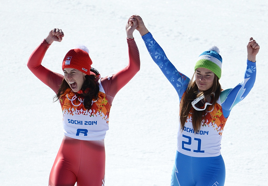 . Gold medallists Slovenia\'s Tina Maze (R) and Switzerland\'s Dominique Gisin stand on the podium at the Women\'s Alpine Skiing Downhill Flower Ceremony at the Rosa Khutor Alpine Center during the Sochi Winter Olympics on February 12, 2014.    AFP PHOTO / KIRILL  KUDRYAVTSEV/AFP/Getty Images