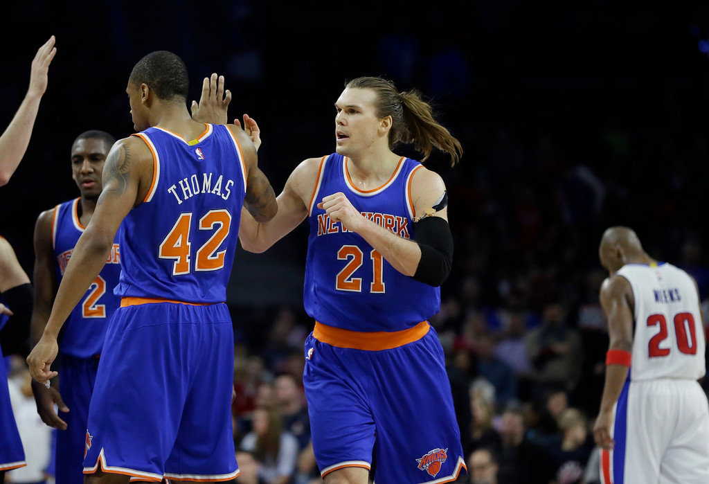 . New York Knicks forward Lou Amundson (21) is congratulated by teammates  as Detroit Pistons guard Jodie Meeks (20) walks back to the bench during the closing seconds of the second overtime of an NBA basketball game, Friday, Feb. 27, 2015 in Auburn Hills, Mich. The Knicks defeated the Pistons 121-115. (AP Photo/Carlos Osorio)