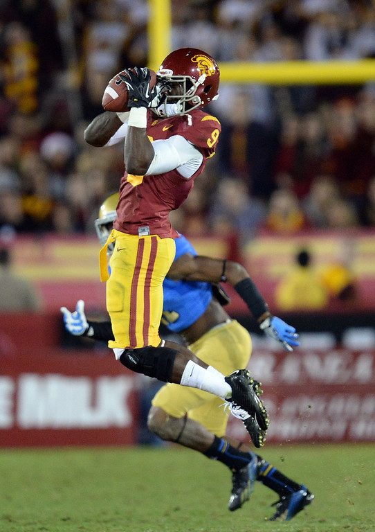 . USC�s Marqise Lee #9 makes a catch during their game at the Los Angeles Memorial Coliseum Saturday, November 30, 2013.  UCLA beat USC 35-14. (Photo by Hans Gutknecht/Los Angeles Daily News)