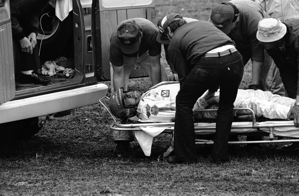. Driver A.J. Foyt, injured when his car flipped during Daytona 500 race on Sunday, Feb. 20, 1978 in Daytona Beach, is transferred from a stretcher to a waiting ambulance in the infield. (AP Photo/BS)