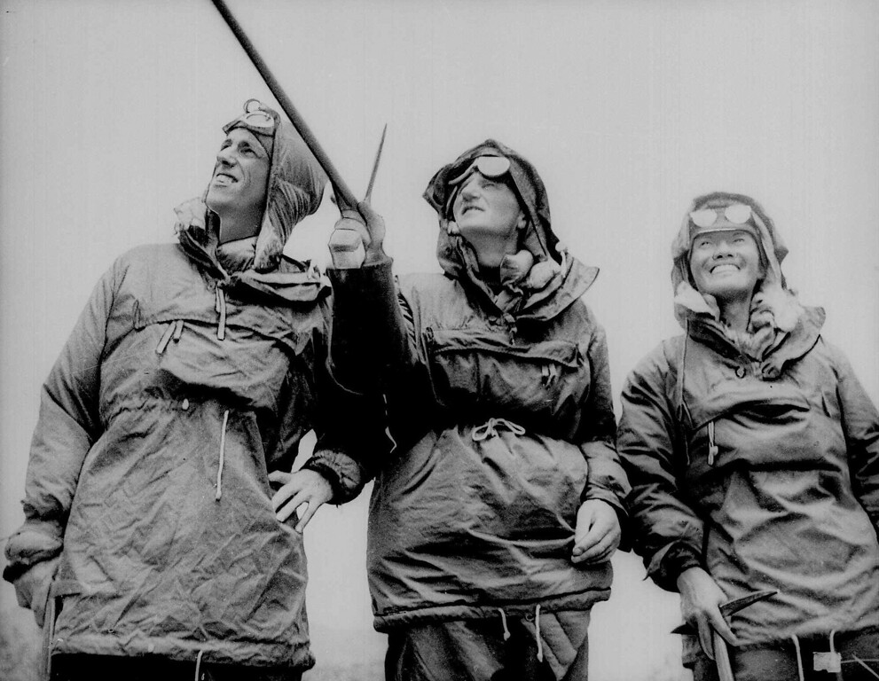. Edmund Hillary, left, Col. John Hunt, and Tenzing Norgay, take a last look at Mount Everest before leaving Katmandu, Nepal in this July 1953 file photo.  Hillary and Norgay share honors as the first men to conquer the world\'s highest peak. Col. Hunt led the British Everest Team of which they were members.   (AP/Photo, File)