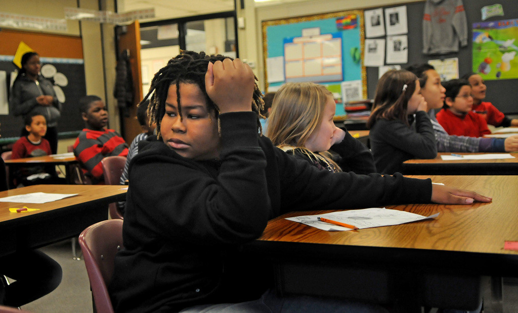". Hamline Elementary fifth-grade student Jarvis Atkinson said he is new to the school. ""It\'s fun and I like the teachers,\"" he said. (Pioneer Press: Jean Pieri)"