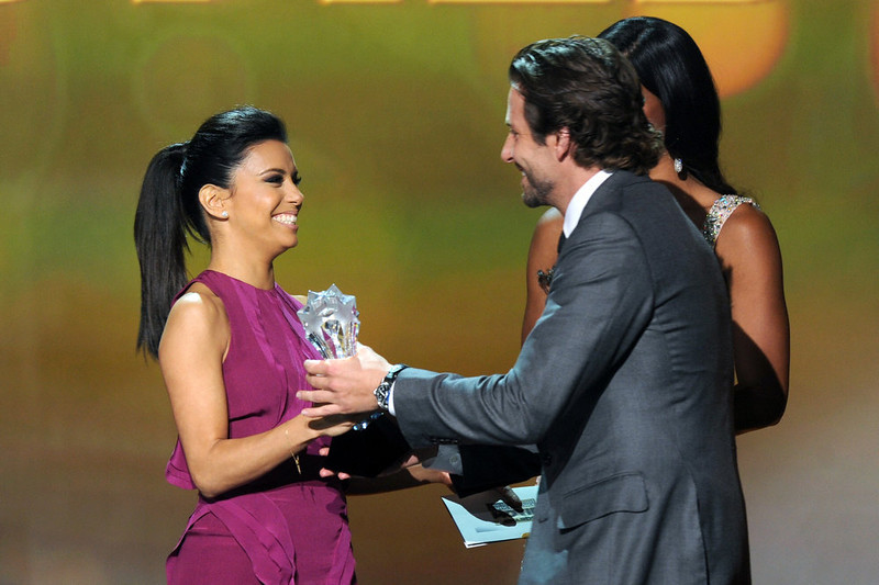 . Actress Eva Longoria (L) presents actor Bradley Cooper onstage at the 18th Annual Critics\' Choice Movie Awards held at Barker Hangar on January 10, 2013 in Santa Monica, California.  (Photo by Kevin Winter/Getty Images)