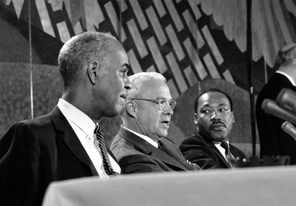 . Mayor Ivan Allen, Jr. of Atlanta, Ga., discusses riots and solutions during a session of the International Platform Association convention in Washington, July 28, 1967. He is flanked by Roy Wilkins, left, executive secretary of the National Association for the Advancement of Colored People and member of President Johnson\'s Special Advisory Commission on Civil Disorders, and Dr. Martin Luther King Jr., head of the Southern Christian Leadership Conference. (AP Photo/Henry Burroughs)
