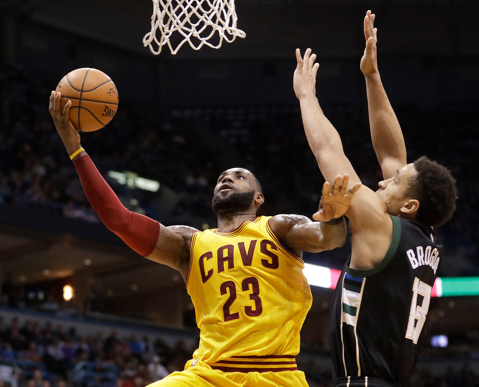 . Cleveland Cavaliers\' LeBron James shoots over Milwaukee Bucks\' Malcolm Brogdon during the first half of an NBA basketball game Tuesday, Dec. 20, 2016, in Milwaukee. (AP Photo/Morry Gash)