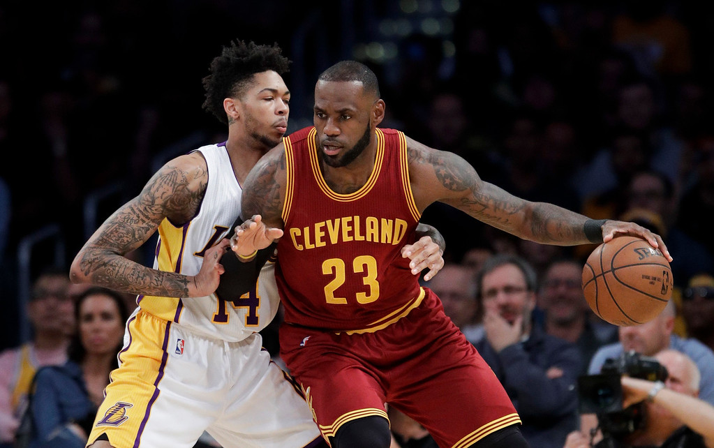 . Cleveland Cavaliers\' LeBron James, right, is defended by Los Angeles Lakers\' Brandon Ingram during the first half of an NBA basketball game Sunday, March 19, 2017, in Los Angeles. (AP Photo/Jae C. Hong)