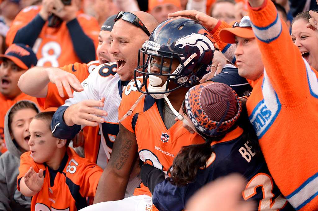 . Denver Broncos wide receiver Demaryius Thomas #88 celebrates his touchdown with fans during the third quarter.  The Denver Broncos vs The Tampa Bay Buccaneers at Sports Authority Field Sunday December 2, 2012. John Leyba, The Denver Post