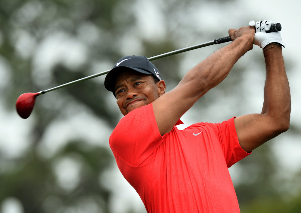 Description of . Tigers Woods of the US hits a shot during the final round of the 77th Masters golf tournament at Augusta National Golf Club on April 14, 2013 in Augusta, Georgia.  JEWEL SAMAD/AFP/Getty Images