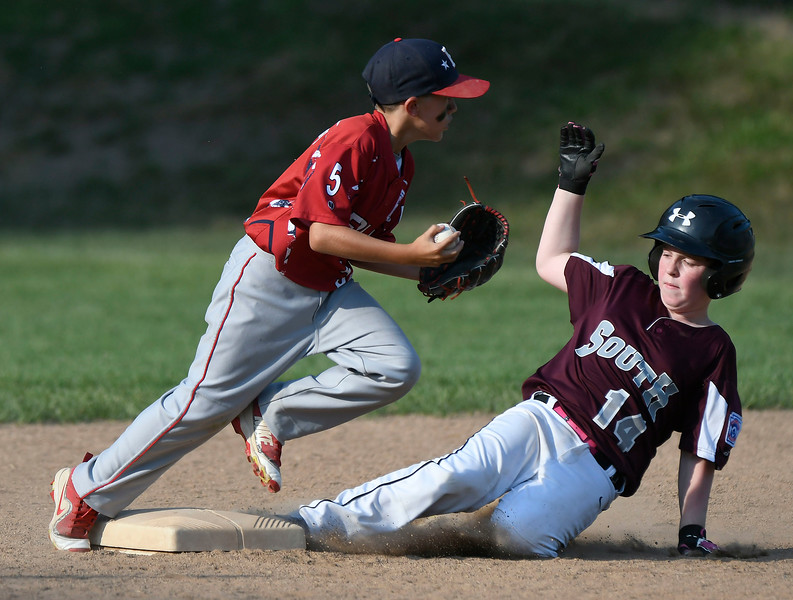 7/10/2018 Mike Orazzi | Staff Southington South's Brayden Dandelski (14) forced out at second by Berlin's Daniel Akier (5) in Bristol Tuesday night.