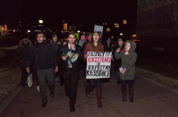 020217 Wesley Bunnell | Staff  The Social Justice Committee of CCSU helped organize a rally on Thursday night on campus to protest the recent immigrant ban.  Second from left and leading the march up are Chairman of the Social Justice Committee Chris Marinelli and Vice Chair Sawera Hussan.