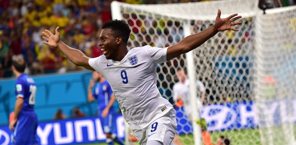 . England\'s forward Daniel Sturridge celebrates after scoring a goal during a Group D football match between England and Italy at the Amazonia Arena in Manaus during the 2014 FIFA World Cup on June 14, 2014.   AFP PHOTO / GIUSEPPE CACACE