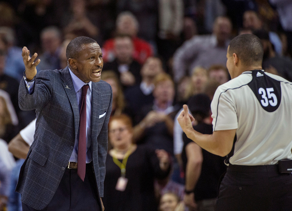 . Toronto Raptors coach Dwane Casey argues a call with referee Steve Anderson (35) during the second half of an NBA basketball game against the Cleveland Cavaliers in Cleveland, Tuesday, Nov. 15, 2016. The Cavaliers won 121-117. (AP Photo/Phil Long)
