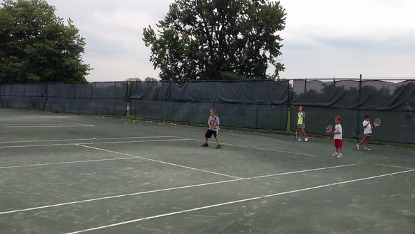 Dusty doing tennis lessons