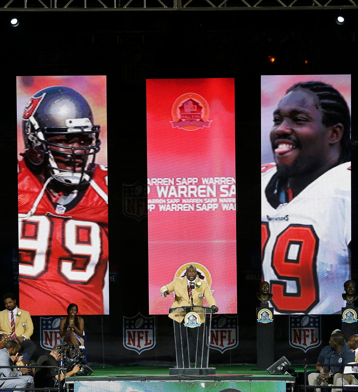 . Former NFL football player Warren Sapp speaks during the induction ceremony at the Pro Football Hall of Fame Saturday, Aug. 3, 2013, in Canton, Ohio. (AP Photo/Tony Dejak)