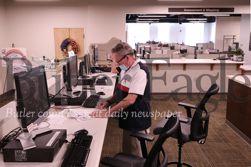 Robert Morrison of Morrison Real Estate Appraisal Service checks county property records at the Government Center's newly opened office space. Seb Foltz/Butler Eagle
