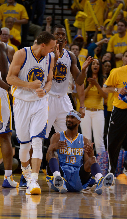 . OAKLAND, CA. - APRIL 26: Stephen Curry (30) of the Golden State Warriors yells out as he looks down at Corey Brewer (13) of the Denver Nuggets sitting on the court after getting called for a foul in game 3 of the first round of the NBA Playoffs April 26, 2013 at Oracle Arena.  (Photo By John Leyba/The Denver Post)