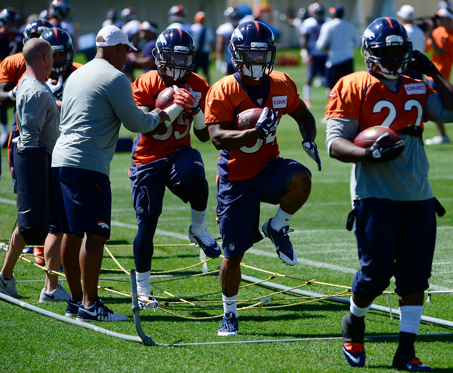 . CENTENNIAL, CO - AUGUST 19: Running backs from right to left C.J. Anderson (22), Brennan Clay (34), and Kapri Bibbs (35) run through drills during practice on Tuesday, Aug. 19, 2014. The Denver Broncos prepare at Dove Valley on Tuesday, Aug. 19, 2014 in Centennial for their upcoming game against the Houston Texans on Saturday, Aug. 23, 2014. (Photo by Kathryn Scott Osler/The Denver Post)