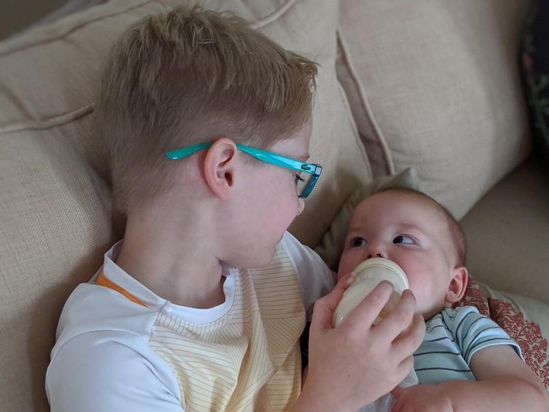Ethan feeding Henri.jpg