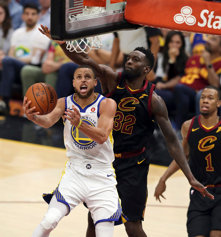 . Golden State Warriors\' Stephen Curry shoots in front of Cleveland Cavaliers\' Jeff Green during the second half of Game 4 of basketball\'s NBA Finals, Friday, June 8, 2018, in Cleveland. (AP Photo/Carlos Osorio)
