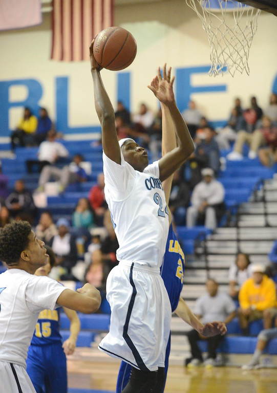 . Compton\'s Deshawn Hill (24) goes up for a shot against La Mirada a first round CIF Division 3AAA basketball game Wednesday night in Compton. 20130213 Photo by Steve McCrank / Staff Photographer