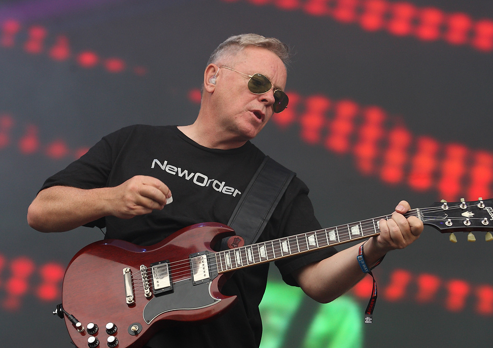 Description of . Bernard Sumner of the English rock band New Order performs on day 1 of Lollapalooza 2013 at Grant Park on Friday, Aug. 2, 2013, in Chicago. (Photo by Steve Mitchell/Invision/AP)