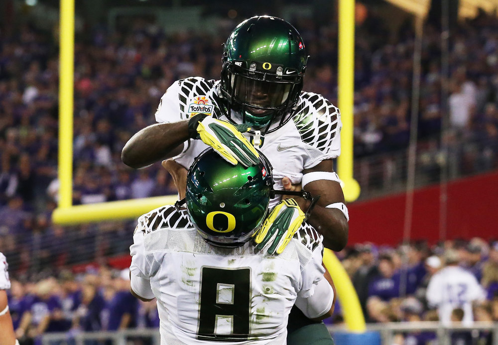 Description of . De'Anthony Thomas #6 celebrates a first quarter touchdown with Marcus Mariota #8 of the Oregon Ducks during the Tostitos Fiesta Bowl against the Kansas State Wildcats at University of Phoenix Stadium on January 3, 2013 in Glendale, Arizona.  (Photo by Stephen Dunn/Getty Images)