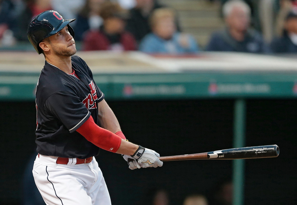. Cleveland Indians\' Yan Gomes watches his ball after hitting a three-run home run off Cincinnati Reds relief pitcher Layne Somsen in the sixth inning of an interleague baseball game, Monday, May 16, 2016, in Cleveland. Mike Napoli and Carlos Santana scored on the play. (AP Photo/Tony Dejak)