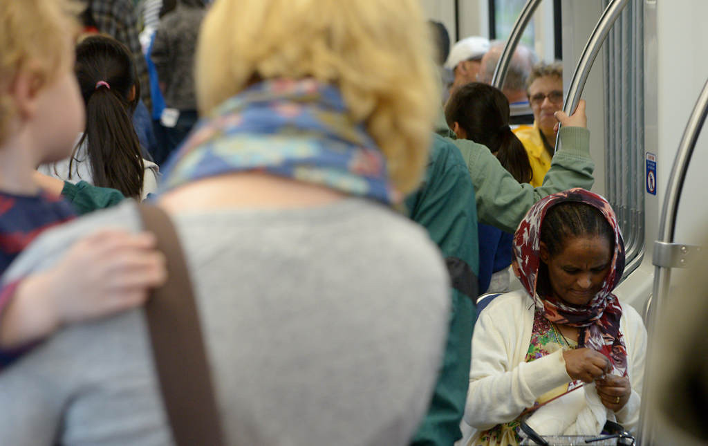 . A women knits while riding the Green Line during the Metro Transit Green Line Grand Opening in St. Paul, Saturday June 14, 2014. (Pioneer Press: John Autey)