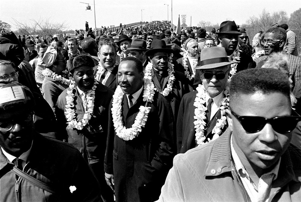 . Martin Luther King, Jr. and his civil rights marchers head for Montgomery, the state\'s capitol, in this March 21, 1965 file photo. (AP Photo, File)