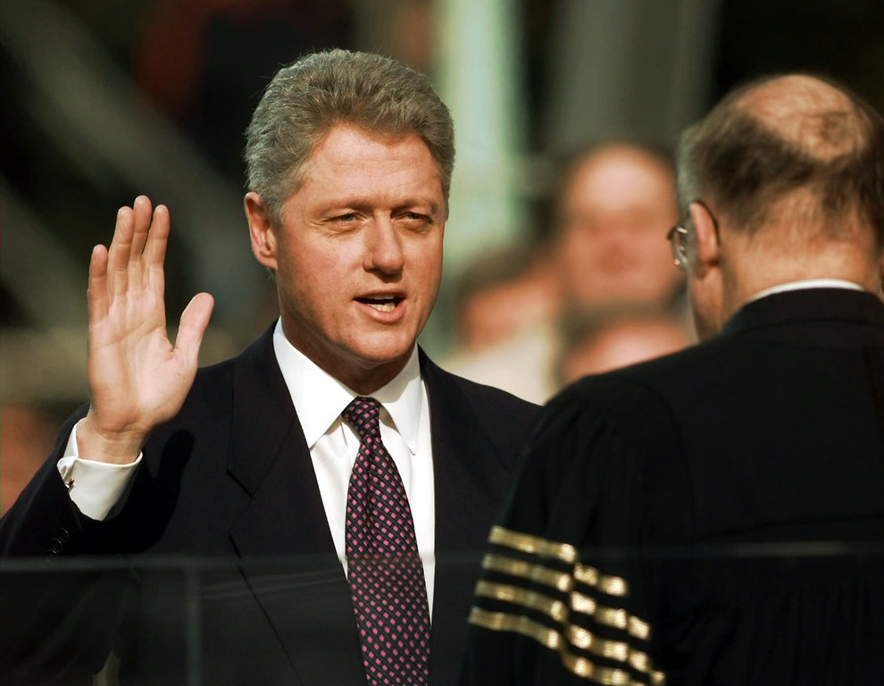 . President Clinton is sworn in for his second term by Supreme Court Chief Justice William Rehnquist during the 53rd Presidential Inauguration Monday, Jan. 20, 1997, in Washington.  (AP Photo/J. Scott Applewhite)