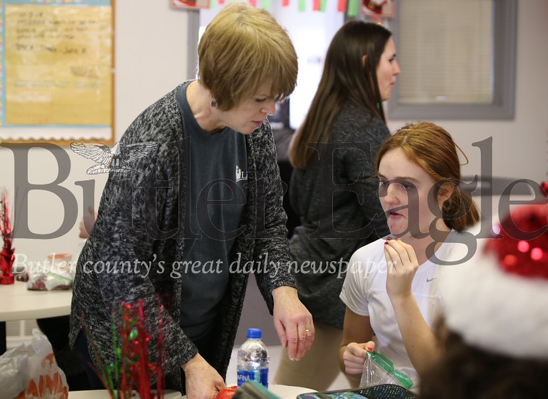 Instructor's assistant Kathy Rudolph assists Lifesteps program member Courtney at lunch. Seb Foltz/Butler Eagle