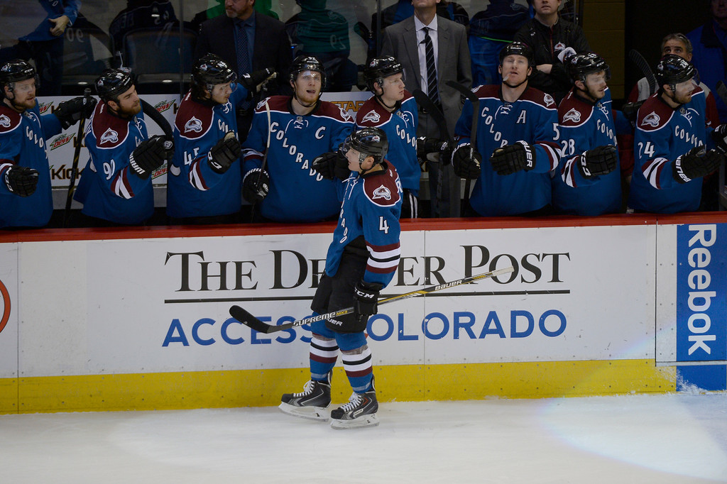 . DENVER, CO - FEBRUARY 16: Colorado Avalanche defenseman Tyson Barrie (4) fist bumps teammates after his goal on Arizona Coyotes goalie Mike McKenna (43) during the second period February 16, 2015 at Pepsi Center. (Photo By John Leyba/The Denver Post)