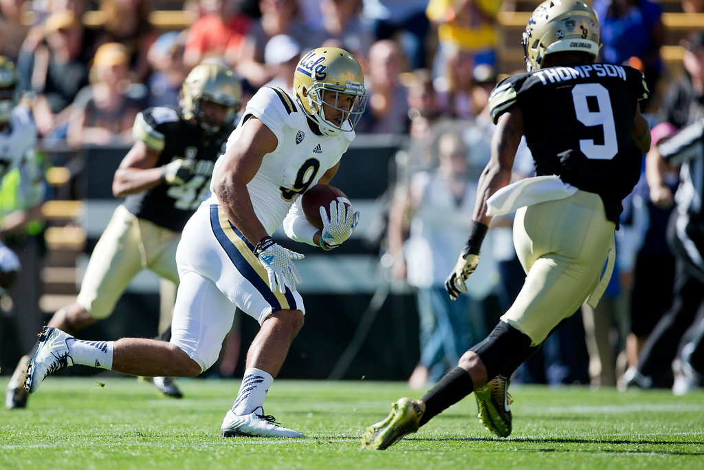. BOULDER, CO - OCTOBER 25:  Wide receiver Jordan Payton #9 of the UCLA Bruins runs past defensive back Tedric Thompson #9 of the Colorado Buffaloes for a touchdown during the first quarter at Folsom Field on October 25, 2014 in Boulder, Colorado. (Photo by Justin Edmonds/Getty Images)